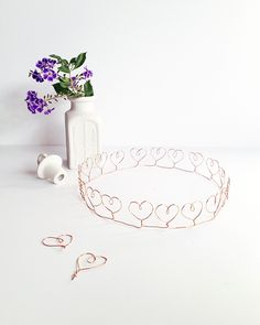 heart crown made with 20 gauge copper wire...could string beads on as you are making the hearts...also could just make  a few hearts and the rest of the crown plain.
