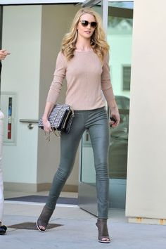 20 different ways to wear leather pants and leggings this fall: Rosie Huntington Whiteley styles her leather leggings with a casual sweater and booties.