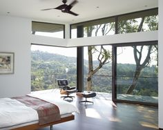 Cottage Bedrooms Designs, like the open space, oversize sliding windows, Herman Miller Eames lounge & ottoman and of course a balcony off the master bedroom.