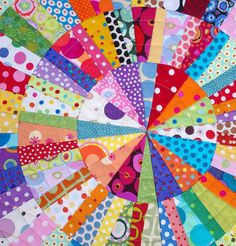 Red Pepper Quilts  It is a foundation pieced quilt, with each individual full circle made from 12 arcs, and consisting of 108 pieces of fabric.