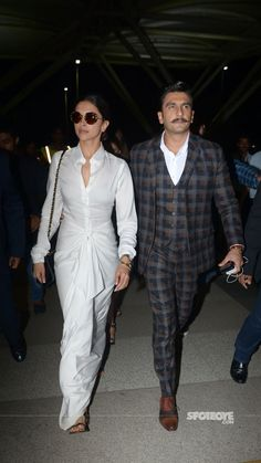 Deepika Padukone & Ranveer Singh, at Mumbai Airport, Return To The City Holding Hands. Love all white outfit, with a sarong like bottom, with a brilliant 'twist'. Deepika Padukone Style, Deepika Ranveer, Ranveer Singh, Bollywood Couples, Bollywood Fashion, Western Outfits, Indian Outfits, Rock Dress, Stylish Dress Designs