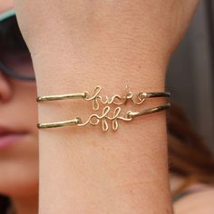 FU*& OFF BRACELET, but i am ordering fu*& it to remind myself to say those 2 words more often!=)