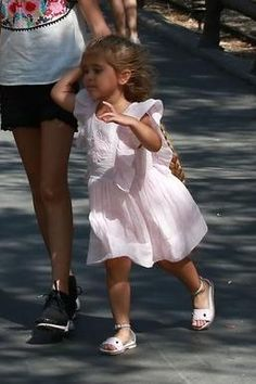 Penelope Disick wearing Fendi Monster Leather Sandals and Fendi Silk Voile Dress