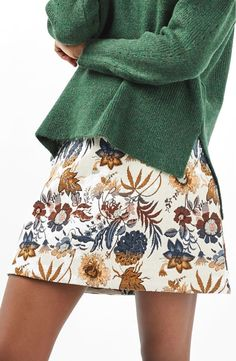 Taking inspiration from '60s designs, this A-line skirt sits high on the waist and is done in a vibrant floral motif.