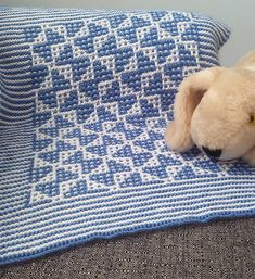 Free Knitting Pattern for Mosaic Butterfly Baby Blanket - Baby blanket in with butterflies knit with easy mosaic colorwork – knit 1 color per row, forming the design by slipping stitches. 3 sizes. DK weight. Designed by Nancy Lekx