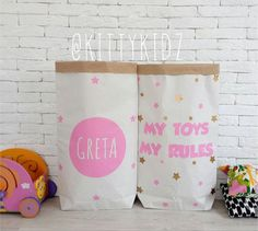 Paper Storage Bag with the name of your Princess would be perfect in a nursery or childs room, filled to the brim with your little ones favourite toys. Make a game of filling it back up again following a play session.  Theyre made of triple craft paper and sticked with funky, brightly-coloured crown and name of your baby girl. The paper bags are durable and reusable many times over and would bring an industrial chic vibe to your childs room or around the home. They fold away neatly into a…