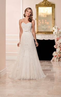 Mary Me Bridal Wedding Dress. This strapless wedding dress by Stella York features french tulle gathered at the sweetheart neckline revealing a slice of romantic lace with Diamante beading. The A-line gown zips up under fabric-covered buttons. Find it at marymebridal.net/