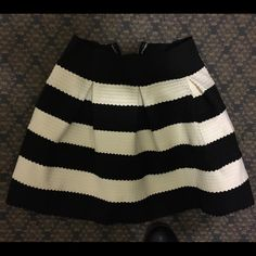 Black and white stripe skirt Super unique material! Thick so it stays in shape(pic2) pearl on the back! Perfect for party  Everyone would love it Skirts Mini