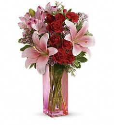 Hold Me Close Bouquet:  It's a statement she'll always hold close to her heart-lovely lilies and radiant roses that speak to your love and devotion. Arranged lovingly into a pink glass vase, this is a bouquet that brightens any day.
