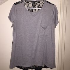 "Lace Back Tee Lace back tee from Forever 21 - small front pocket - gray front with black lace back - hi-low style - worn/washed a few times - back lace has minimal fraying at the bottom hem - measures 26"" from shoulder to front hem & 28"" from shoulder to back - front: 96% rayon, 4% spandex - back: 87% nylon, 13% spandex - hand wash/lay flat to dry Forever 21 Tops Tees - Short Sleeve"