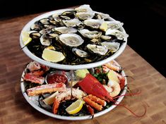 Plateau de Fruits de Mer 101: learn how to cook lobster, crab, mussels and shrimp, how to shuck oysters and clams, and how to make 3 dipping sauces.