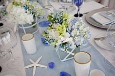 A gallery showing how to use shells & starfish to accent centerpieces, bouquets, tables, favors & more. http://www.yourweddingcompany.com