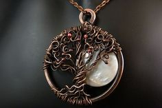 Full Moon Shine  Handcrafted Celtic Tree of Life Pendant - A natural polished shell moon provides the backdrop for this intricate copper wire wrapped tree of life. This beautiful pendant is suspended from a polished natural leather necklace that can be personalized to your preferred length. Optional copper chain or raw brown leather necklace are available although the black leather with a handmade clasp is our recommendation. by SkyAndBeyond,