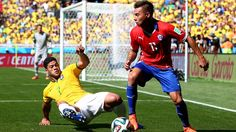 Eduardo Vargas of Chile is tackled by Hulk of Brazil Saturday, 28 June 2014 BELO HORIZONTE, BRAZIL - JUNE 28: Eduardo Vargas of Chile is tackled by Hulk of Brazil during the 2014 FIFA World Cup Brazil Round of 16 match between Brazil and Chile at Estadio Mineirao on June 28, 2014 in Belo Horizonte, Brazil. (Photo by Alex Grimm - FIFA/FIFA via Getty Images)
