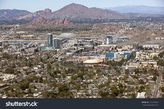stock-photo-skyline-of-downtown-tempe-arizona-with-the-papago-buttes-and-camelback-mountain-in-the-distance-131270924.jpg (1500×1002)