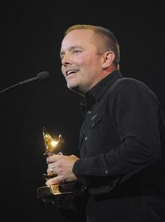 Chris Tomlin receives the Praise and Worship Album Award at the 44th Annual GMA Dove Awards at Lipscomb University. Tuesday Oct. 15, 2013, in Nashville, Tenn.