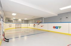 Have an unused basement? How about transforming it into an indoor hockey rink (how very Canadian of you). My dream basement. Synthetic Ice Rink, Ice Hockey Rink, Backyard Hockey Rink, Hockey Bedroom, Basement House, Man Cave Home Bar, Reno, Bars For Home, Play Houses