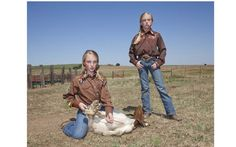 Carsen and Cooper, 10-year-old twins, practising goat-tying at their ranch in Canadian, Texas. Picture: Ilona Szwarc