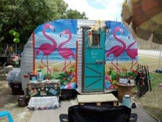 elaborately themed mini caravan with pink flamingos and bright colours