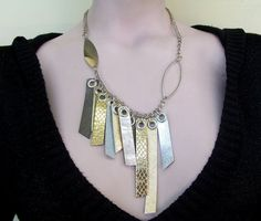 I LOVE mixing silver and gold. And I love the asymmetry of this piece, as well as all its fun little quirks. Neat!