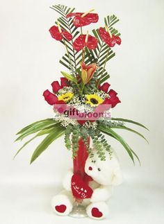 Romantic Gift Ideas Forever  Elegant bouquet with roses, lilies, sunflowers, anthurium, based on gel glass decorated and complemented with a beautiful teddy bear. Tamaño:35*100cm. Size: 35 * 100cm.