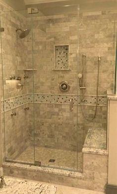 Stone Tile Walk-In Shower Design | Kenwood Kitchens in Columbia, Maryland | Marble Tile Shower with Stone Mosaic | Walk-In Shower with Seated Bench by Raelynn8 #RemodelingIdeasfortheHouse