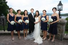 Bridesmaids in different styles of navy blue dresses.  The guys wore black which always goes well together.  VanDixhorn wedding, Inn at Erlowest.  Photo by Out of the Ordinary Photography.