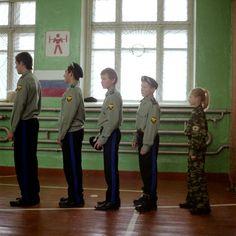 Olivia Arthur RUSSIA. 2007. Ilynskoye. Students at a remote village school train during a cossack class. Magnum Photos Photographer Portfolio