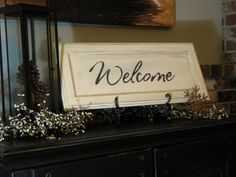 blue roof cabin: Welcome Sign out of Cabinet Door