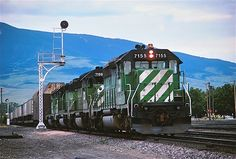 https://flic.kr/p/PccJdB   BN 7155                   6-88   BN 7155 leads a van train east with a couple Boeing cars up front at Livingston MT.