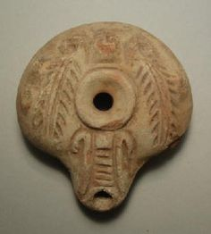 Roman Egypt, 3rd - 4th Century AD. A mould made 'frog' lamp, ovoid in shape with rounded carination and inward sloping rim. The maker's mark 'W' on base.