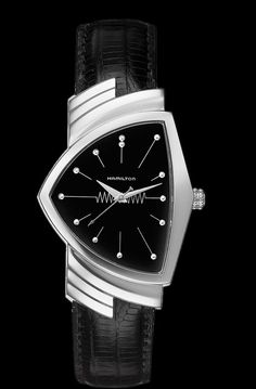 I've lusted after the Hamilton Ventura for years.  It was the first battery operated wristwatch, and it's cool styling is a little piece of modern design history.