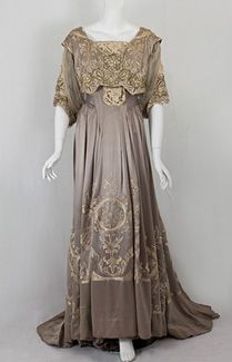 A Belle Epoque Callot Soeurs dinner dress, ca 1905. Callot Soeurs was renowned for masterful use of lace embroidery & for one-of-a-kind embroideries. Made from dove gray silk charmeuse, this exemplar of the Callot style is lavishly hand embroidered with silk floss & subtle gold metallic thread. The lace inserts are of handmade Venetian lace.