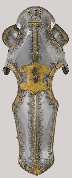 """The Art of Power chmid, German, documented 1513–1579, Saddle from the """"Mühlberg Garniture"""" of Charles V, Augsburg 1544, etched, embossed, and gilt steel, Patrimonio Nacional, Real Armería, Madrid  32 of 51    Desiderius Helmschmid, German, documented 1513–1579, Chanfron from the """"Mühlberg Garniture"""" of Charles V, Augsburg, 1544, 1544, etched, embossed, and gilt steel, Patrimonio Nacional, Real Armería, Madrid"""