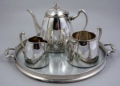 A Scottish Art Nouveau - Era Silver Tea Set (Teapot, Cream, and Sugar) and  An English Cut-Glass and Silver Round Serving Tray with Handles http://antiqueswan.com/
