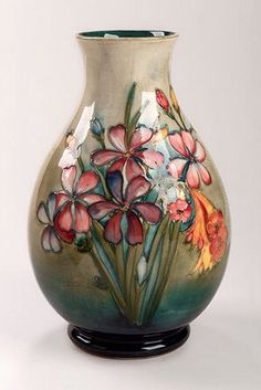 A Moorcroft Baluster vase, decorated in the 'Spring Flowers' pattern, impressed marks, initialled in blue.