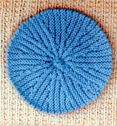 """Reversible Potholder - This is really fun to knit! Like a pinwheel design, only this one is easy, made on 2 needles! People tell us they also use this for a dishcloth! Make lots of various colors for gift giving. Put one by each placemat for a """"ladies luncheon"""" party as a party favor! Finished size is 8¼ inches in diameter. Uses worsted weight yarn, and knitting needles, US # 8.  $2.25"""