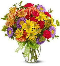 @ FDH Make a Wish @  A summery mix of yellow daisy chrysanthemums, purple asters and hot pink and orange carnations  and  hot pink miniature carnations, orange carnations and alstroemeria - accented with bupleurum  For Other Details Visit - http://flowersdeliveryhouston.com/houston-florist/occasions/make-someone-smile-flowers/fdh-make-a-wish