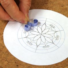"""Lesson 7: Quilling Compound Shapes: Snowflakes. Make Cecelia's Craftsy-famous quilled snowflake by combining shapes; it's easier than it looks! Learn how to quill the marquise and V-scroll shapes, and securely assemble the snowflake on a special surface. Finally, learn a new gluing technique and stamp """"snow"""" on the snowflake for added shine."""