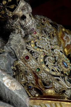 """One of ten full articulated, jeweled skeletons in the town's church, which is the largest intact collection in existence."""