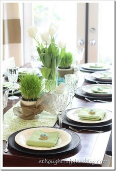 Easter table with chalkboard chargers and mini nests.