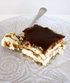 Chocolate eclair cake  1 Box graham crackers (not all will be used)  2 large boxes (5.1 oz) vanilla instant pudding  2 ½ cups skim milk  16 oz reduced fat or fat free cool whip  1 container chocolate frosting