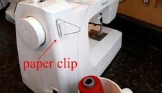 DIY cone thread holder. Make you own out of a paper clip and cd holder or mug.