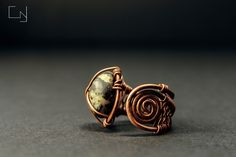 CNJoalharia Wire wrapped ring in copper with a natural stone from the beach.