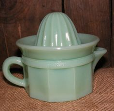 "Jadeite Green Measuring Cup with Juicer - In good condition with no cracks or chips. - Beautiful addition to your Depression Glass collection - Measures about 2 1/5"" tall and 5"" wide (including handle"