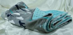 """This is a limited edition crib size blanket and is made with soft airplane print minky on one side and aqua dot minky on the back side.    Average size 36"""" X 30""""    Wash in warm water and dry on low heat setting.    The minky cuddle fabric is taking over the babies and children's products and is very popular among adults and children alike.    Created in a smoke free home    #babyblanket #airplanes #grey #teal 