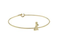"""The solid gold bangle with a """"Lucky Bunny' to bring love and laughter."""