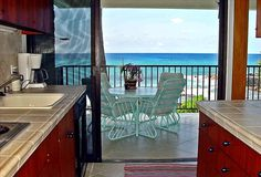 Hale Pōhaku — Oceanfront condo steps from beach & water. Very private 6-unit complex. ❦ Even the chef has a wonderful view of the ocean. ❦ You can view & make reservations for our vacation rental via HomeAway Vacation Rentals.
