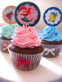 Keep it simple Little Mermaid cupcakes. Just use pink, light blue, light green, and puple icing. Then insert toppers