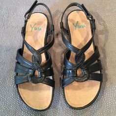 "Brand new pair of Yuu Sandals NWOT black Yuu sandals! Give your feet a treat! If you've ever worn ""Clark"" shoes, these are very similar! Super soft bed! Hate to give them up but just too small now. Please ""NO LOW BALLERS! These are brand new.  Shoes are excluded from bundles. Thank you for stopping by. Happy Poshing! Yuu Shoes Sandals"